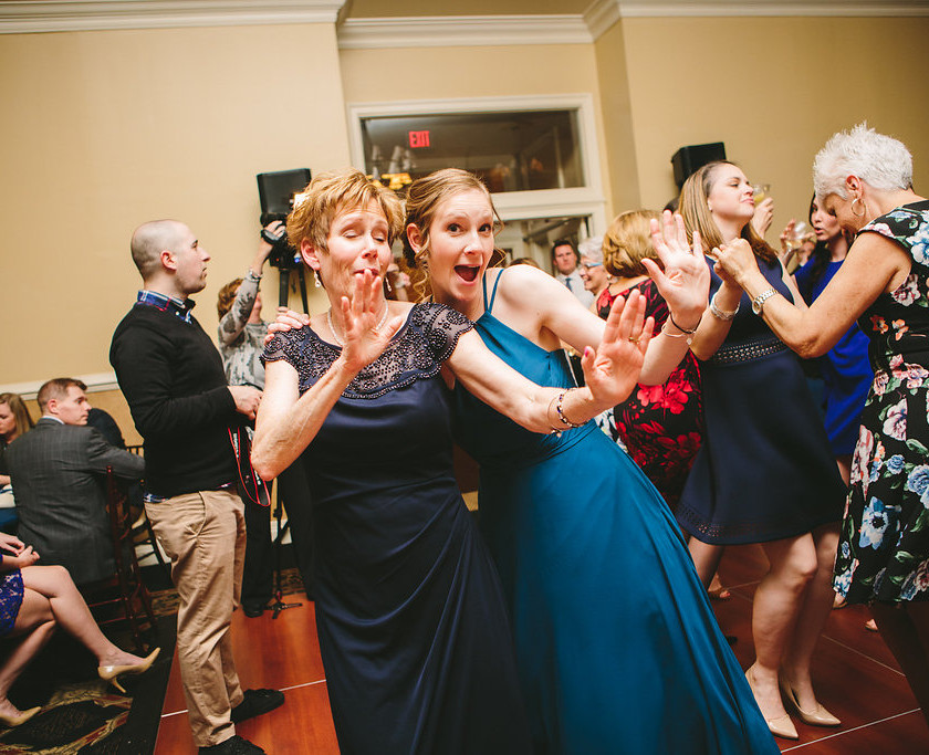 woman and daughter dance during wedding