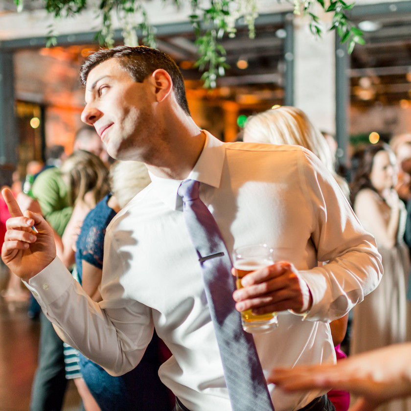 guy dancing while holding a beer
