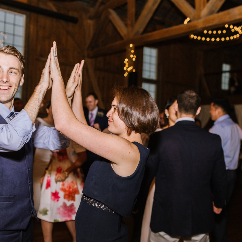 couple does high fives while dancing