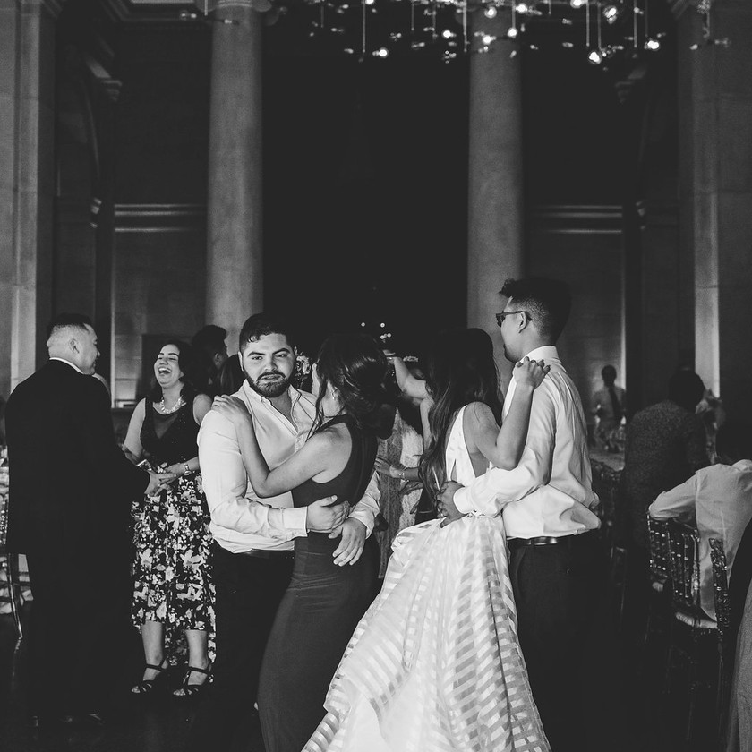 couples slow dance at wedding