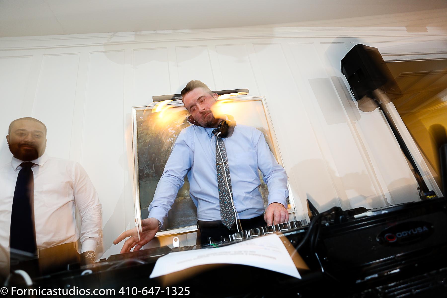 dj spinning music at wedding