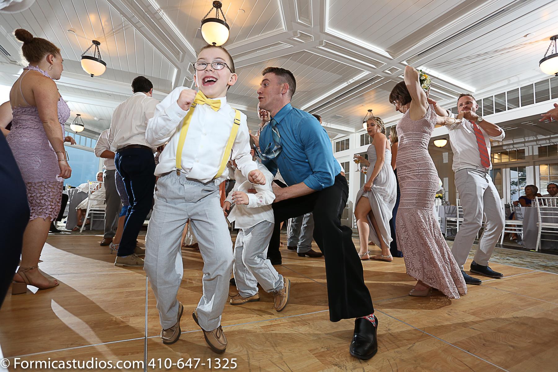 boy in suspenders dancing