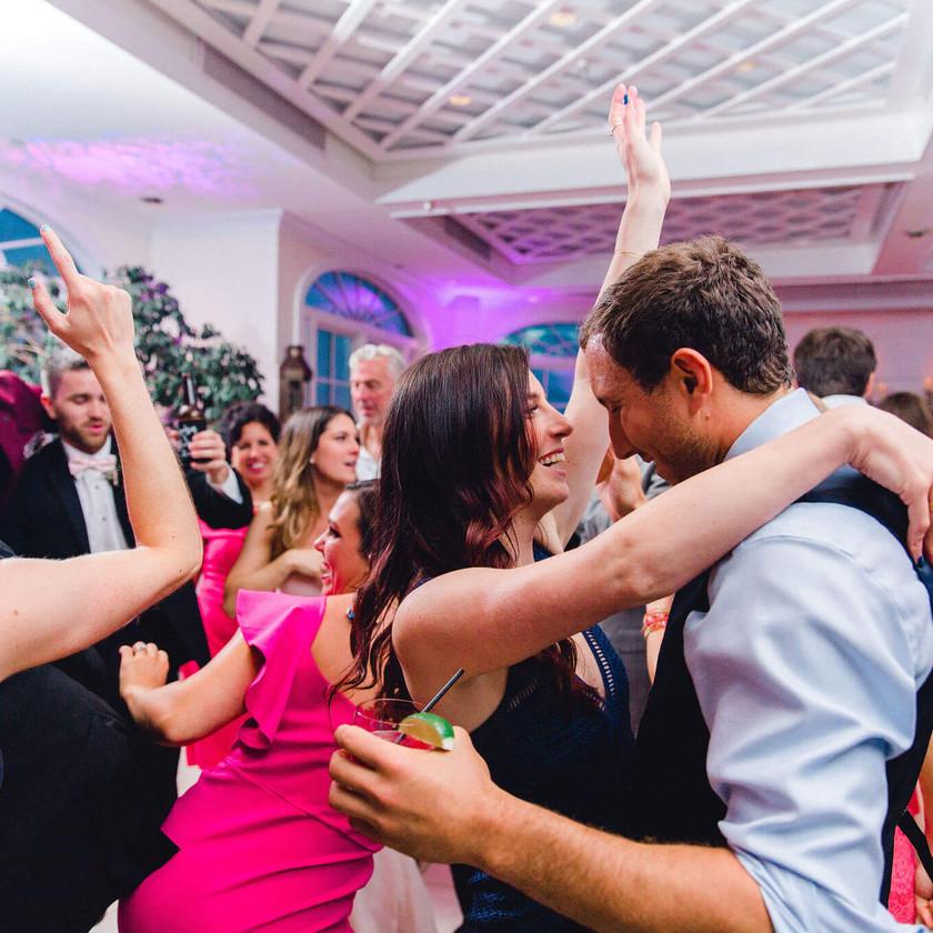 wedding guests dance in garden room of chesapeake bay beach club