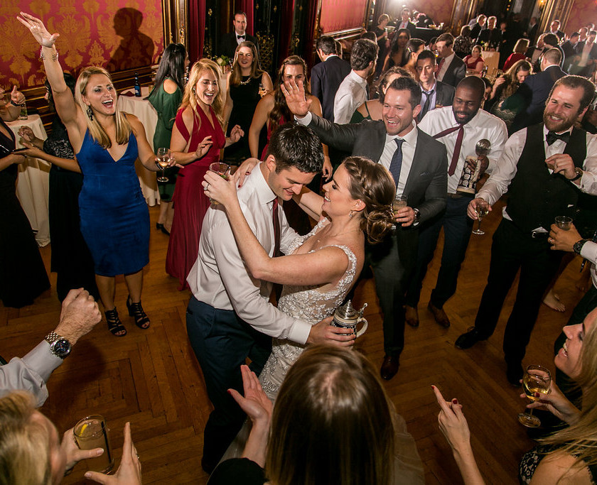 bride and groom dance in center of guests