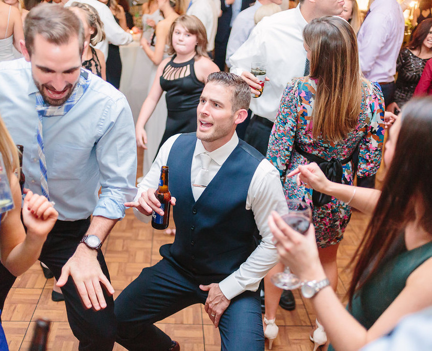 groom dances with friends