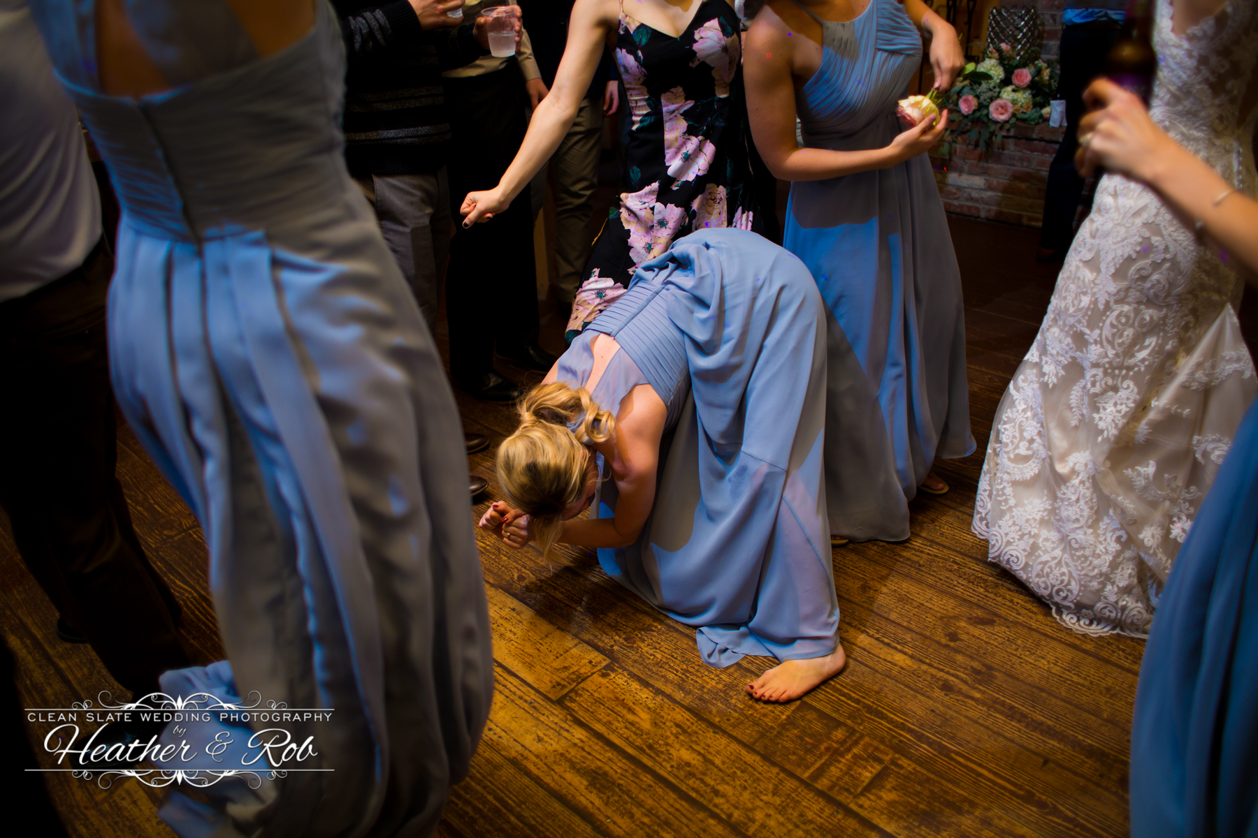 bridesmaid dancing bent over completely at wedding