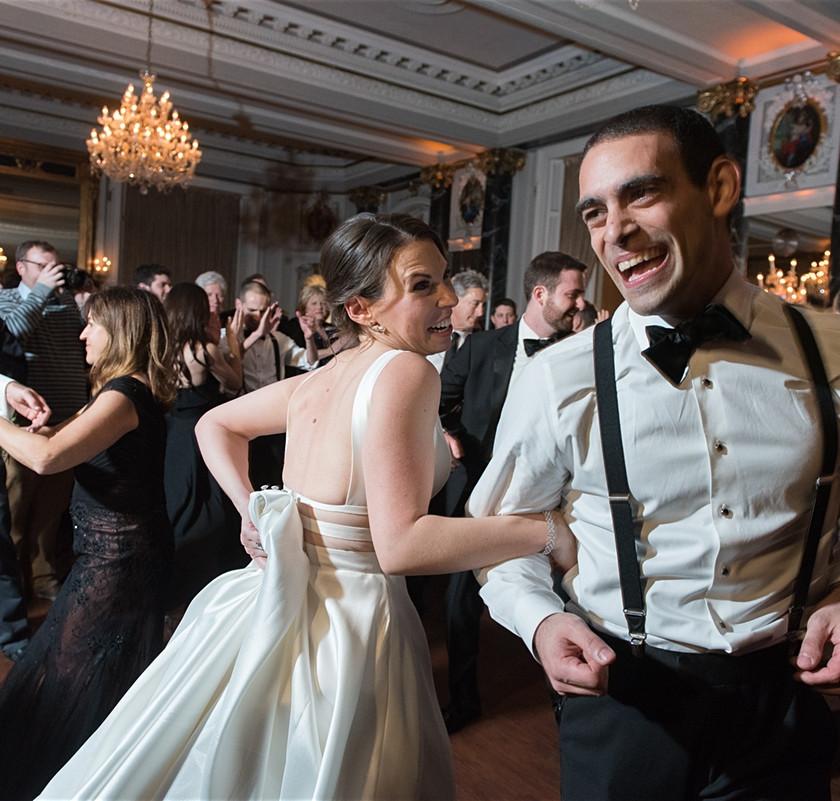 bride spins around with groomsman