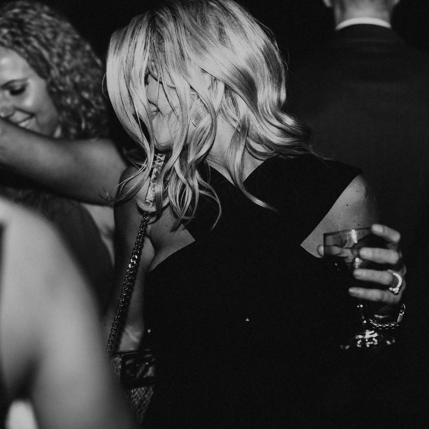 woman in black dress dancing at wedding
