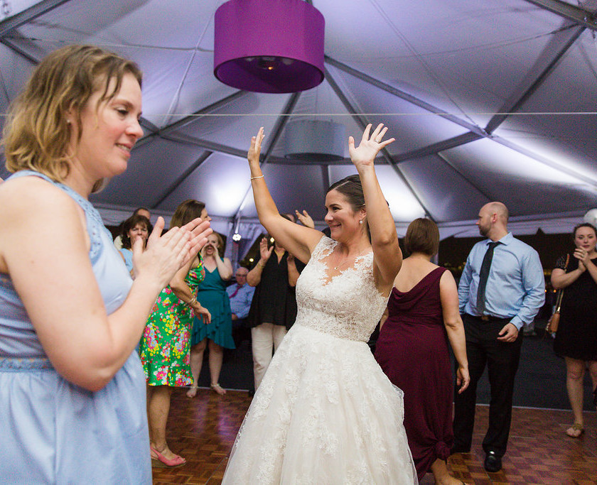 bride dancing with hands up