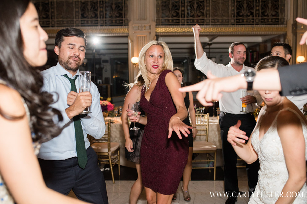 woman in red dress dancing at wedding