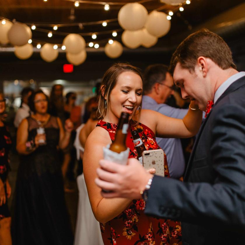 woman and man dance at wedding