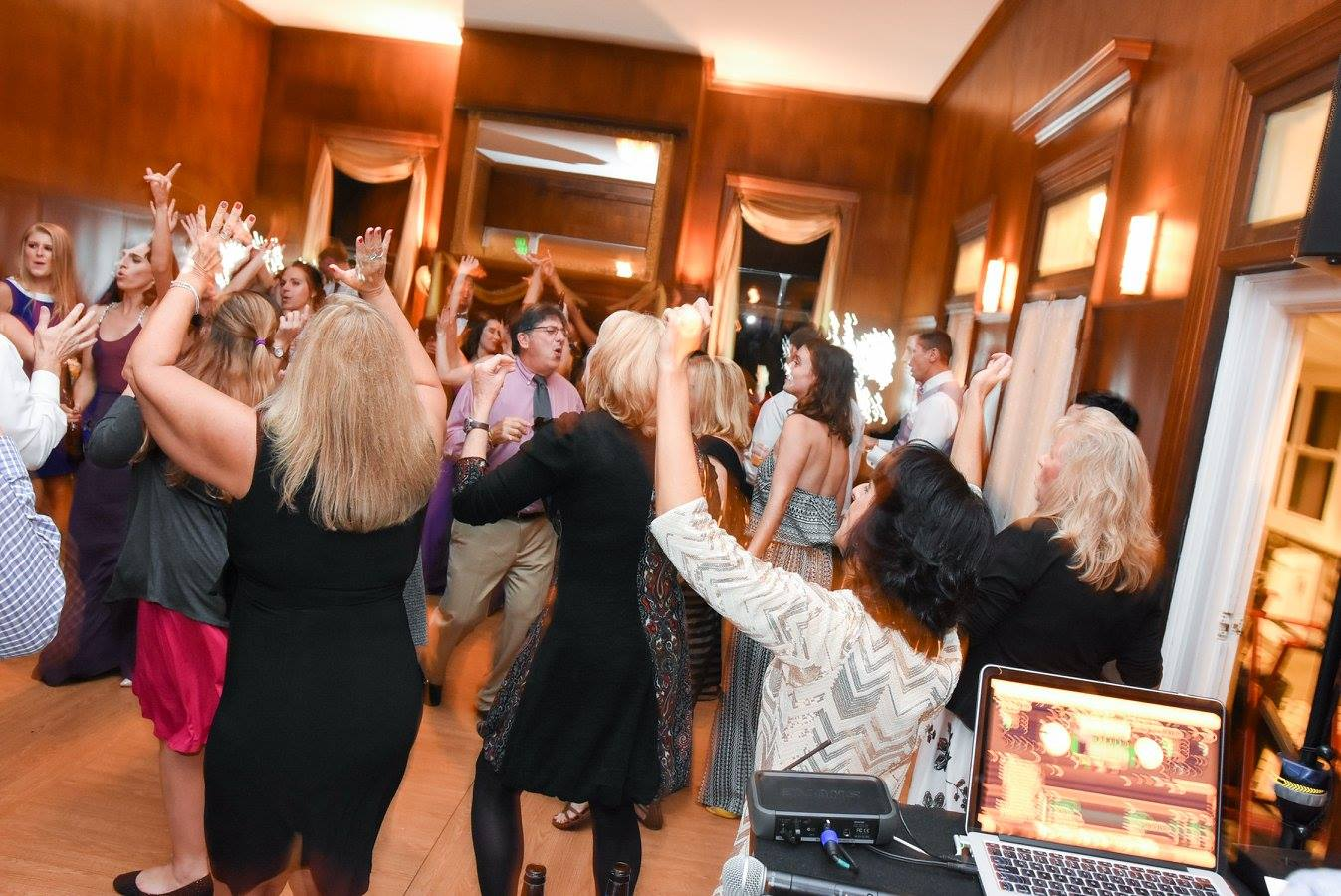 wedding guests dancing with hands up