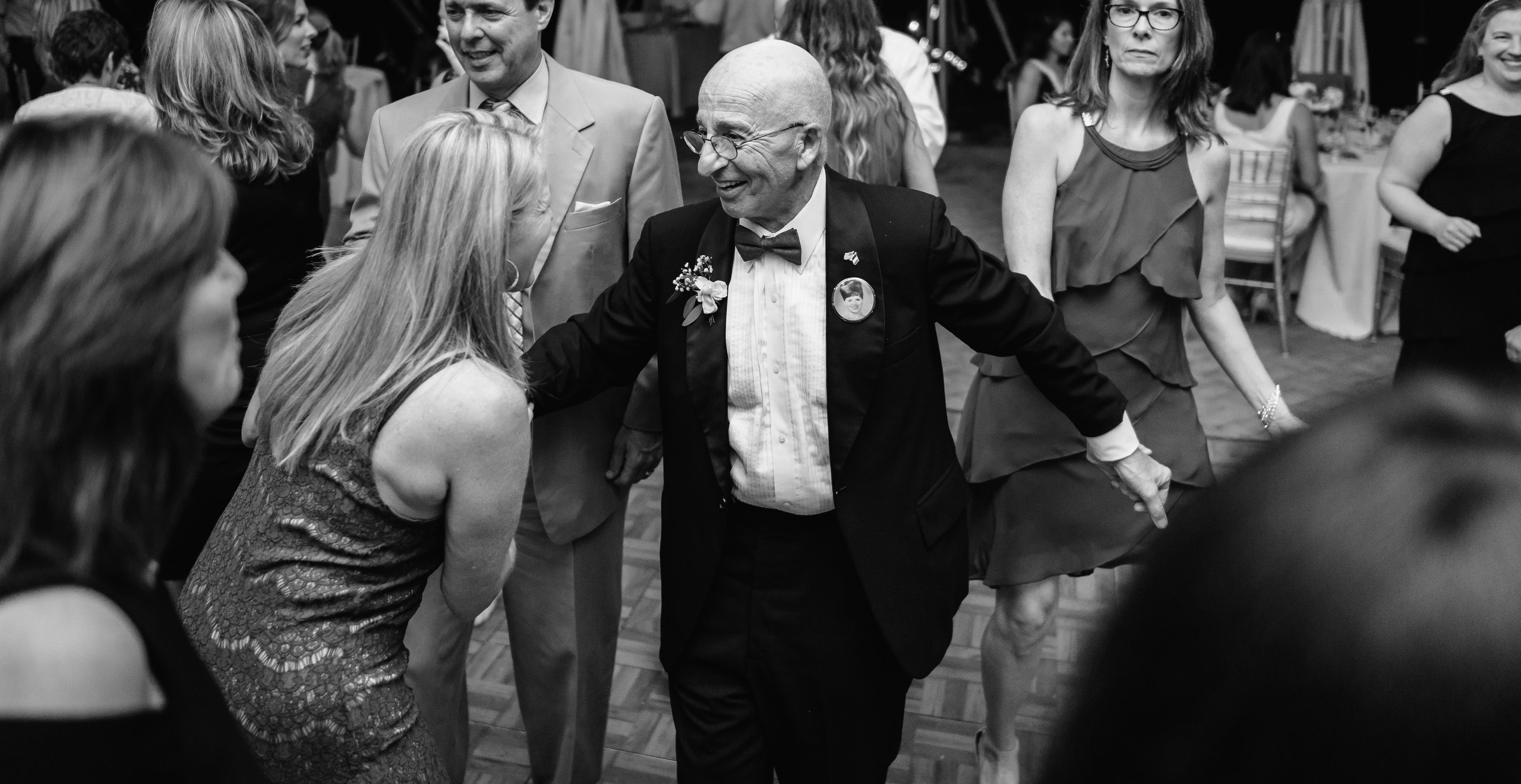 grandfather dancing with guests at wedding
