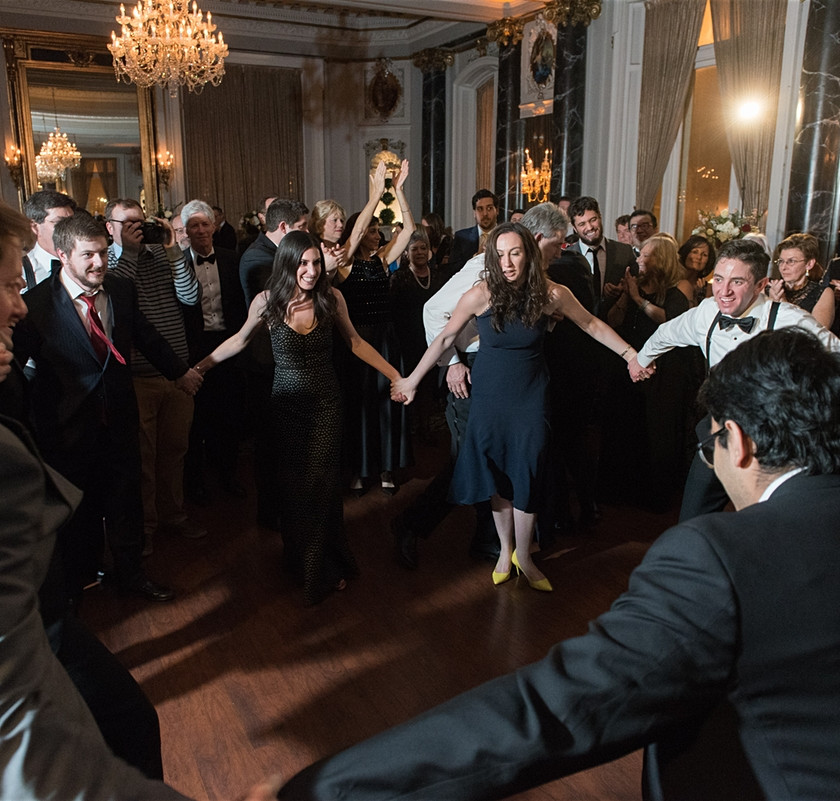 wedding guests dance hand in hand in circle