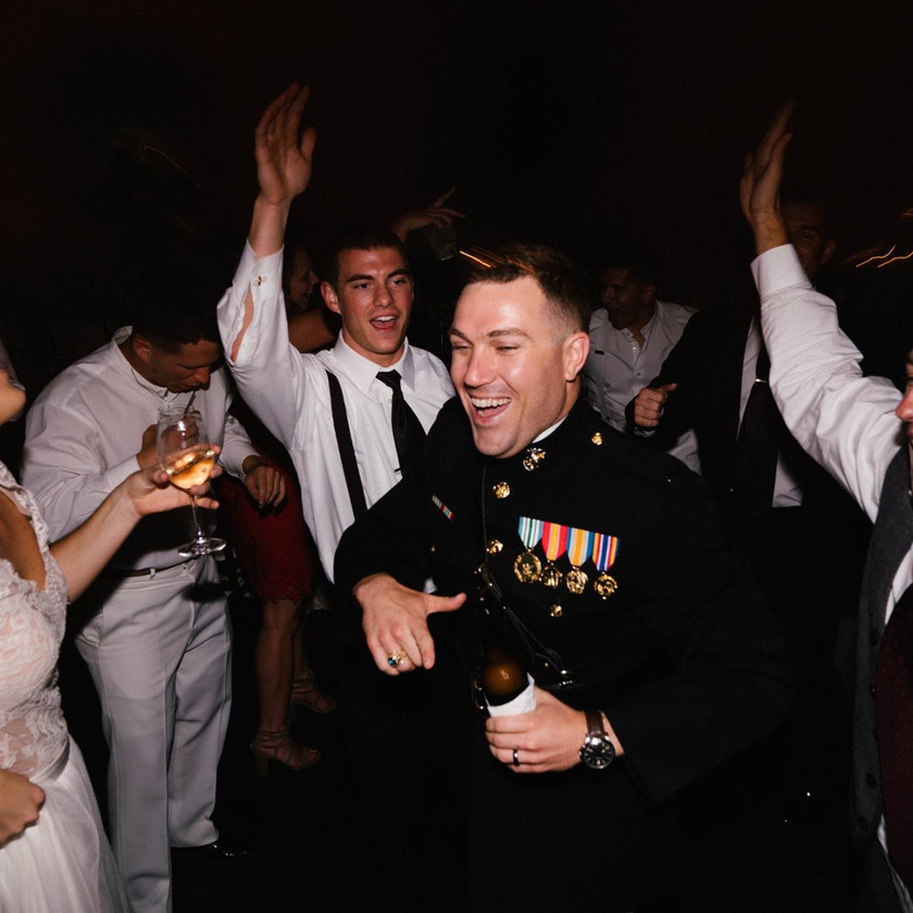 bride and groom dance with guests