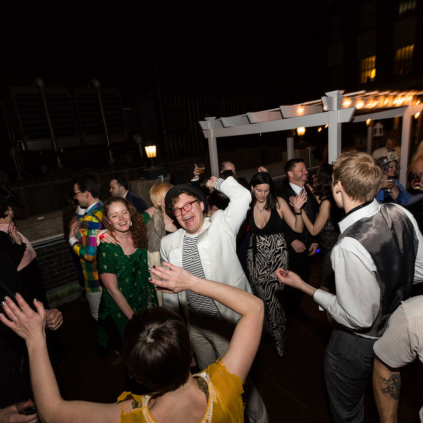 guests dance at rooftop party