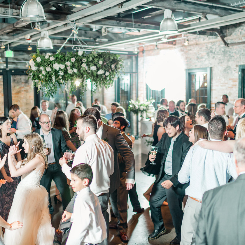 all the wedding guests dancing