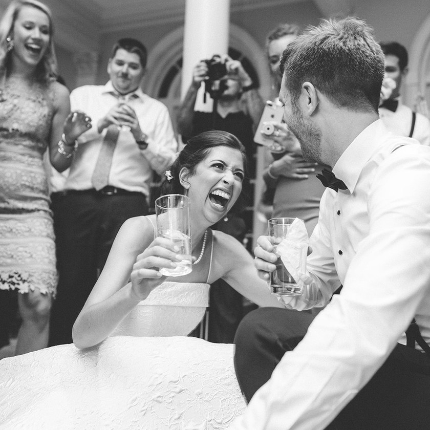 bride and groom drop it low on the floor while dancing