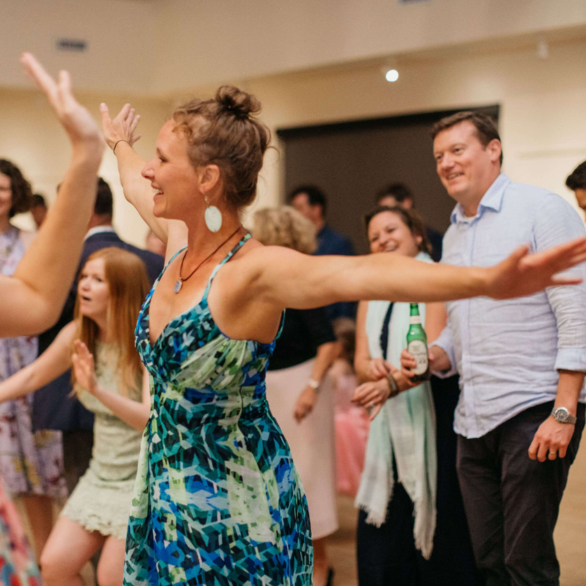 woman in green and blue dress dancing