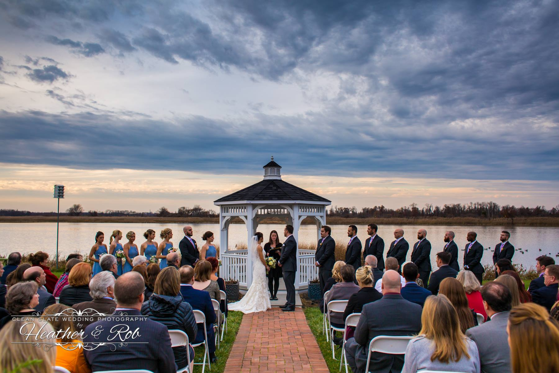 ceremony by gazebo by the water