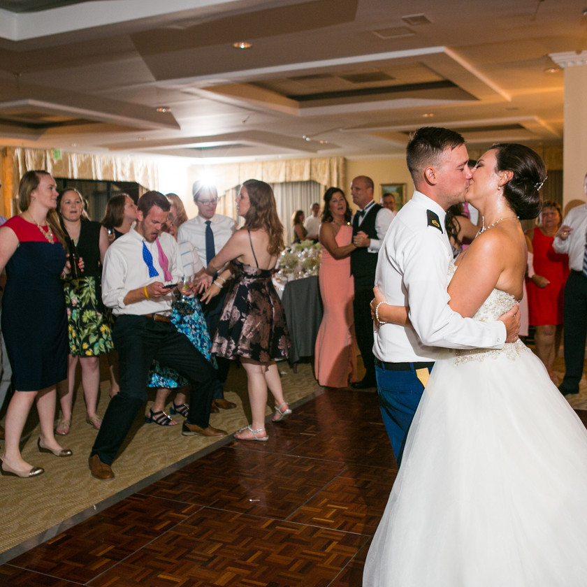 bride and groom kiss while dancing