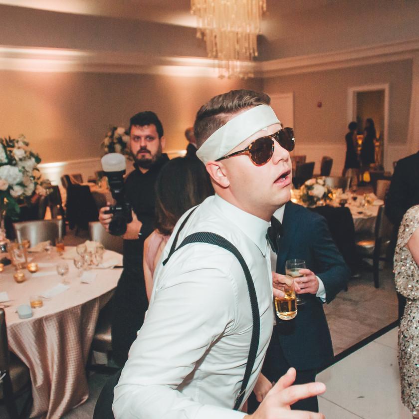 guy with headband dancing at wedding