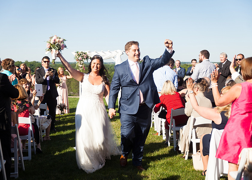 bride and groom walk out of ceremony