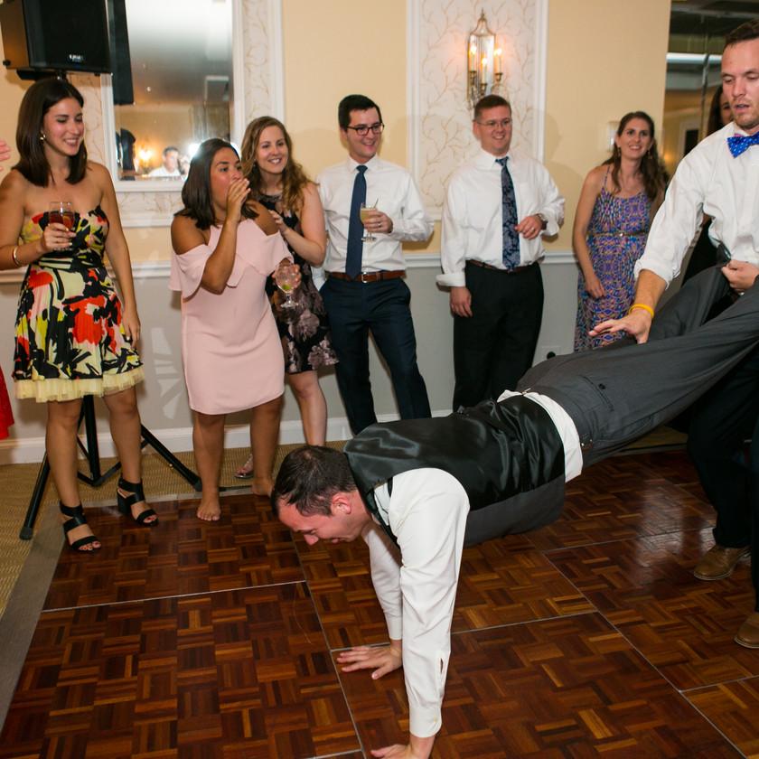 guys doing wheelbarrow on dance floor