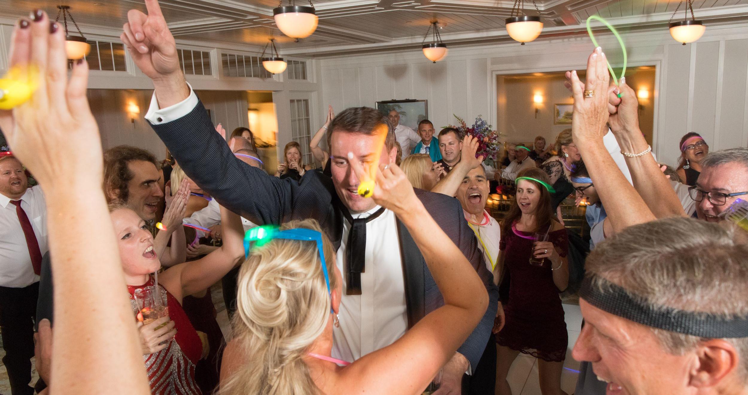 groom dances with hands up