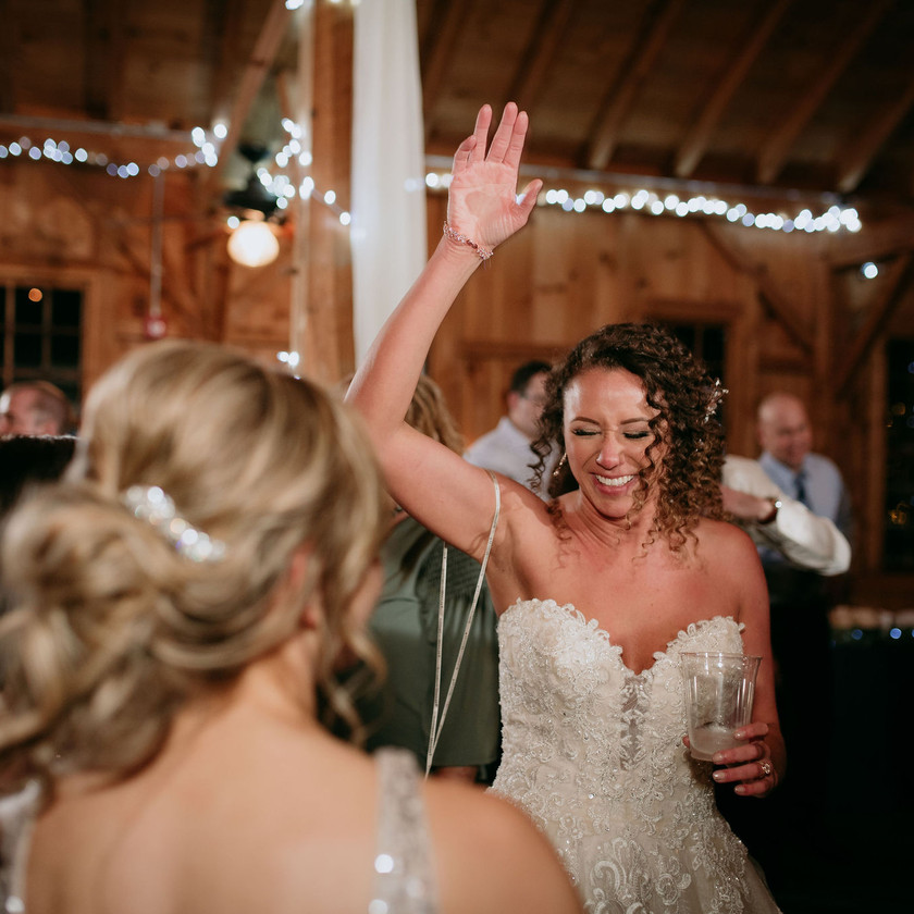 bride smiling and dancing with friends