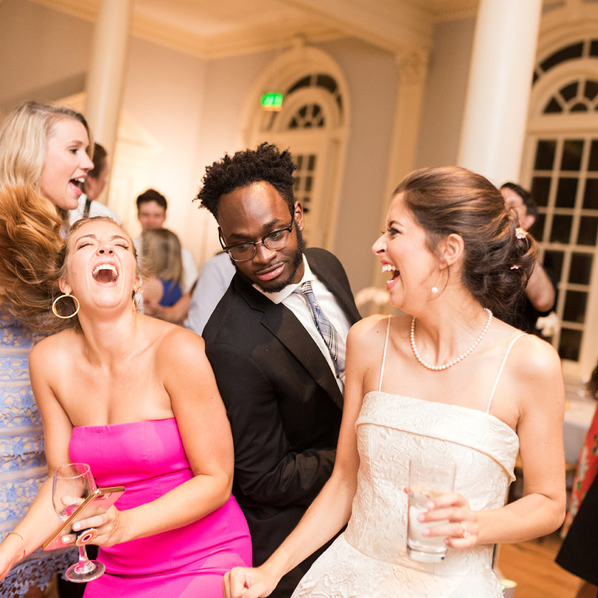 wedding guests and bride dancing