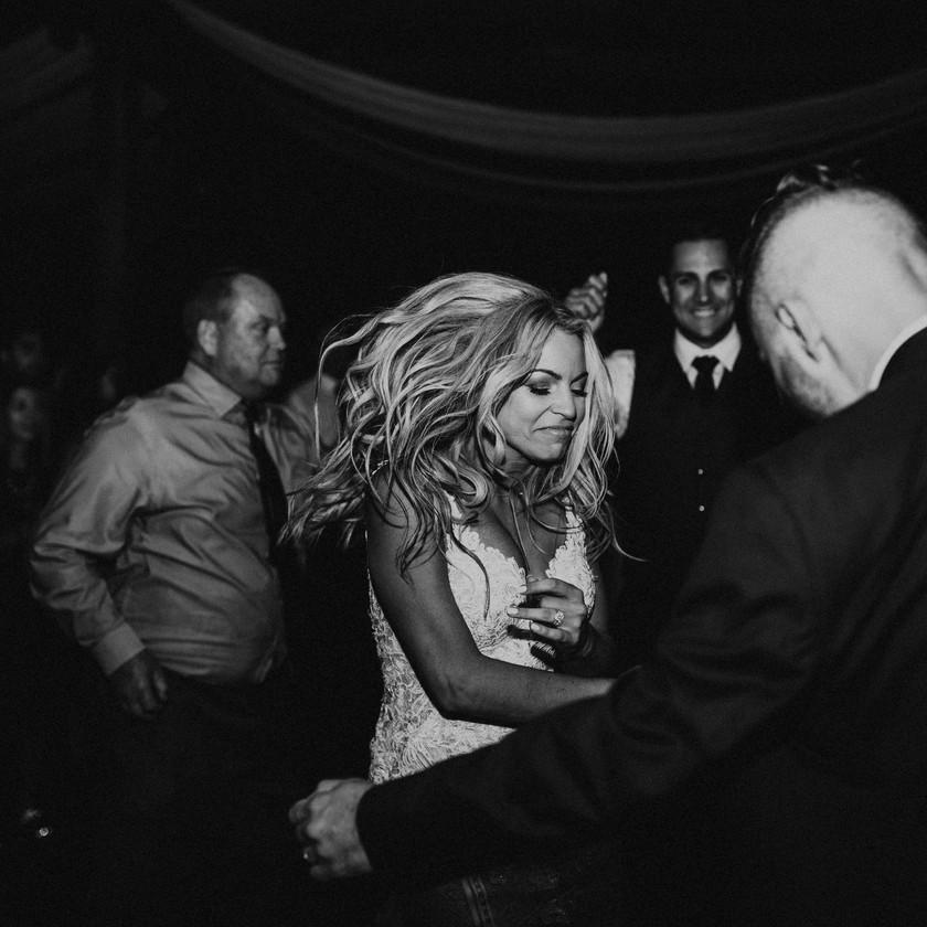 bride dancing with hair bouncing