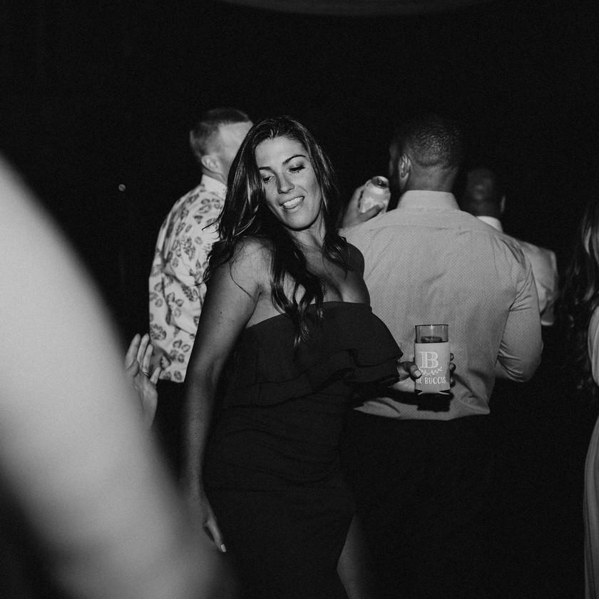 woman in dark dress dancing at wedding