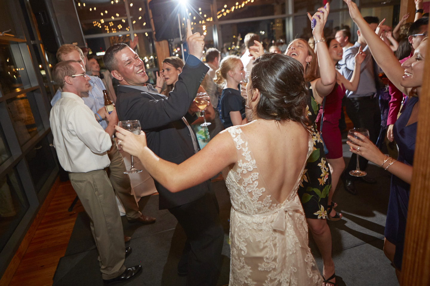 bride dancing with guests during wedding