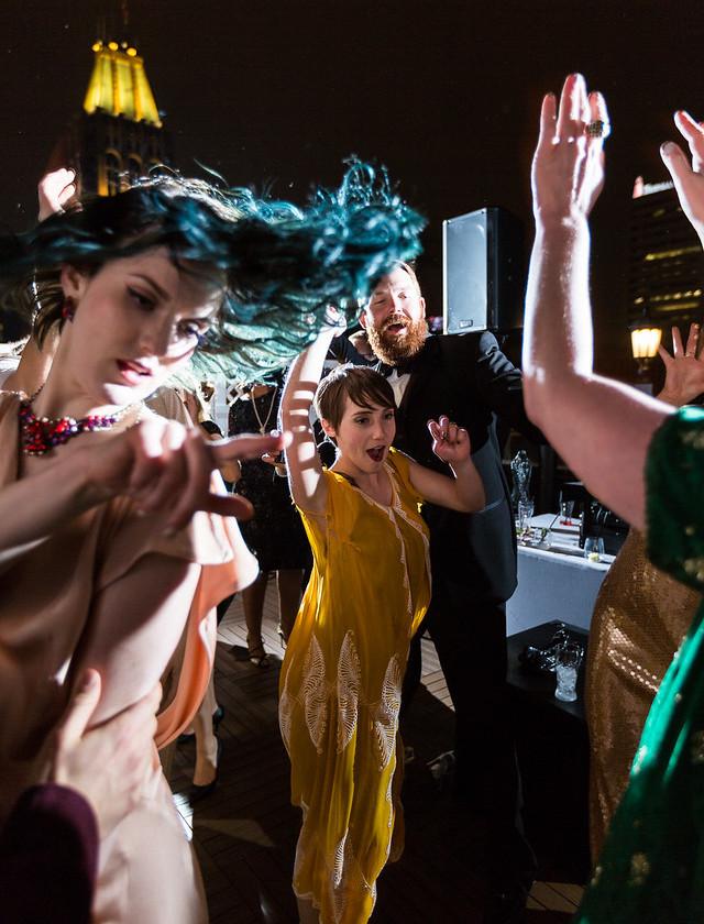 women dance at fancy party