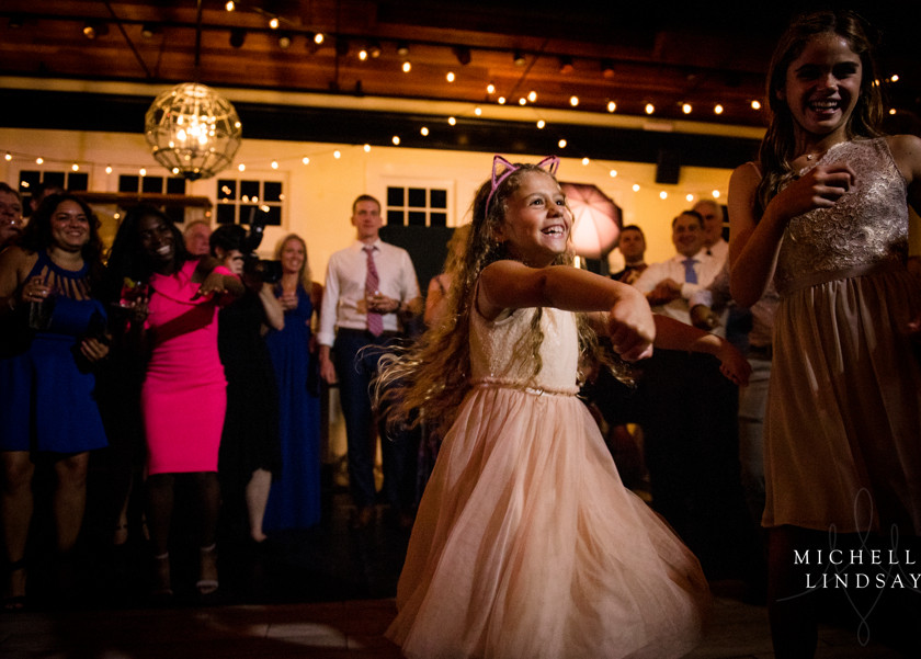 young girl dances at wedding