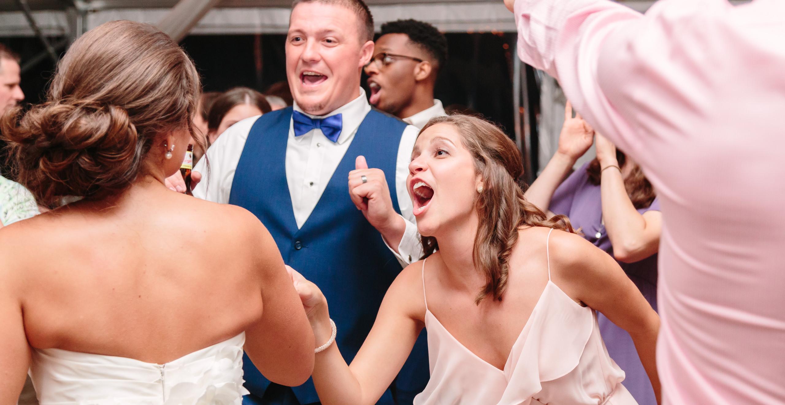 groom, bride and bridesmaid singing