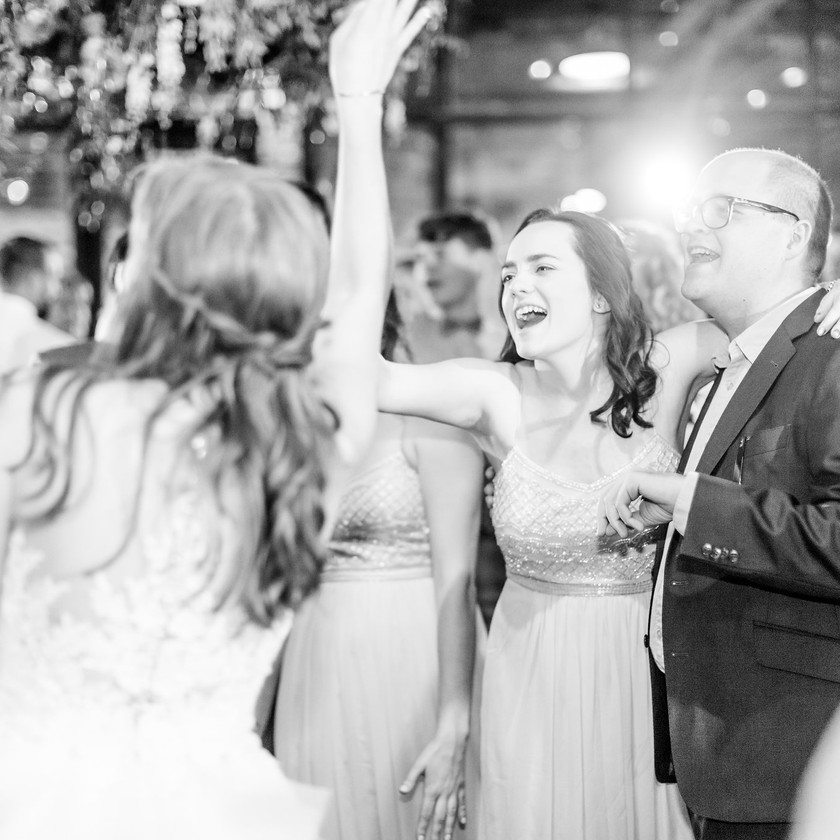 bridesmaid singing with father on dance floor