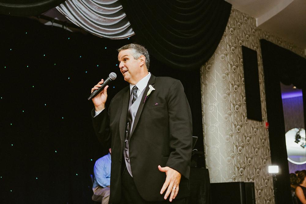 man giving toast at wedding