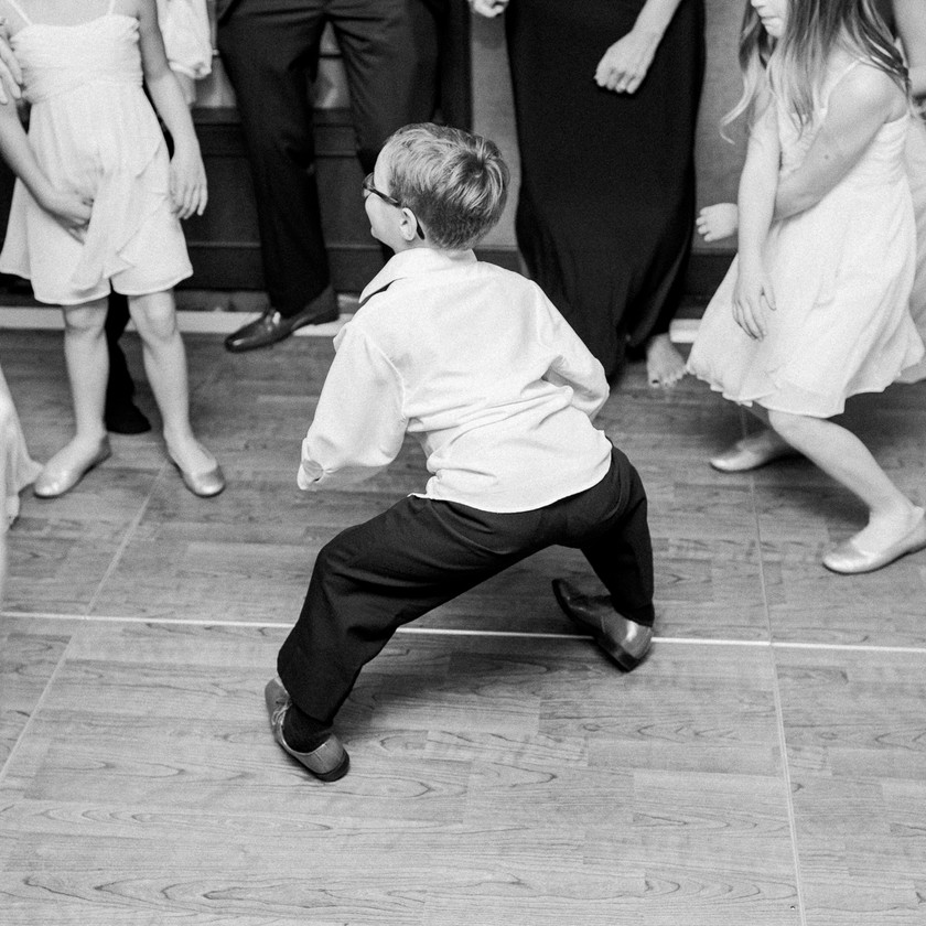 boy dances at wedding