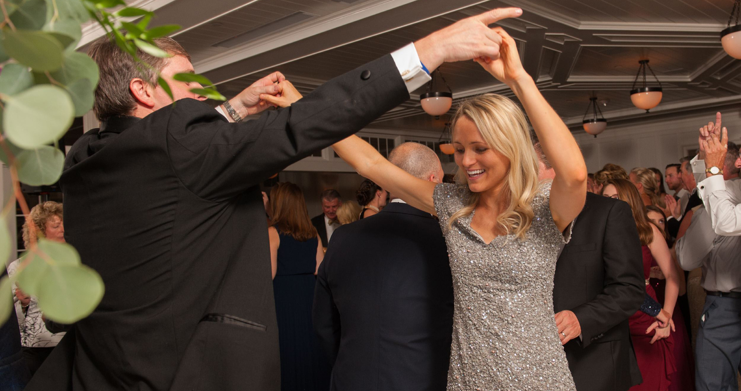 man and woman dancing at wedding
