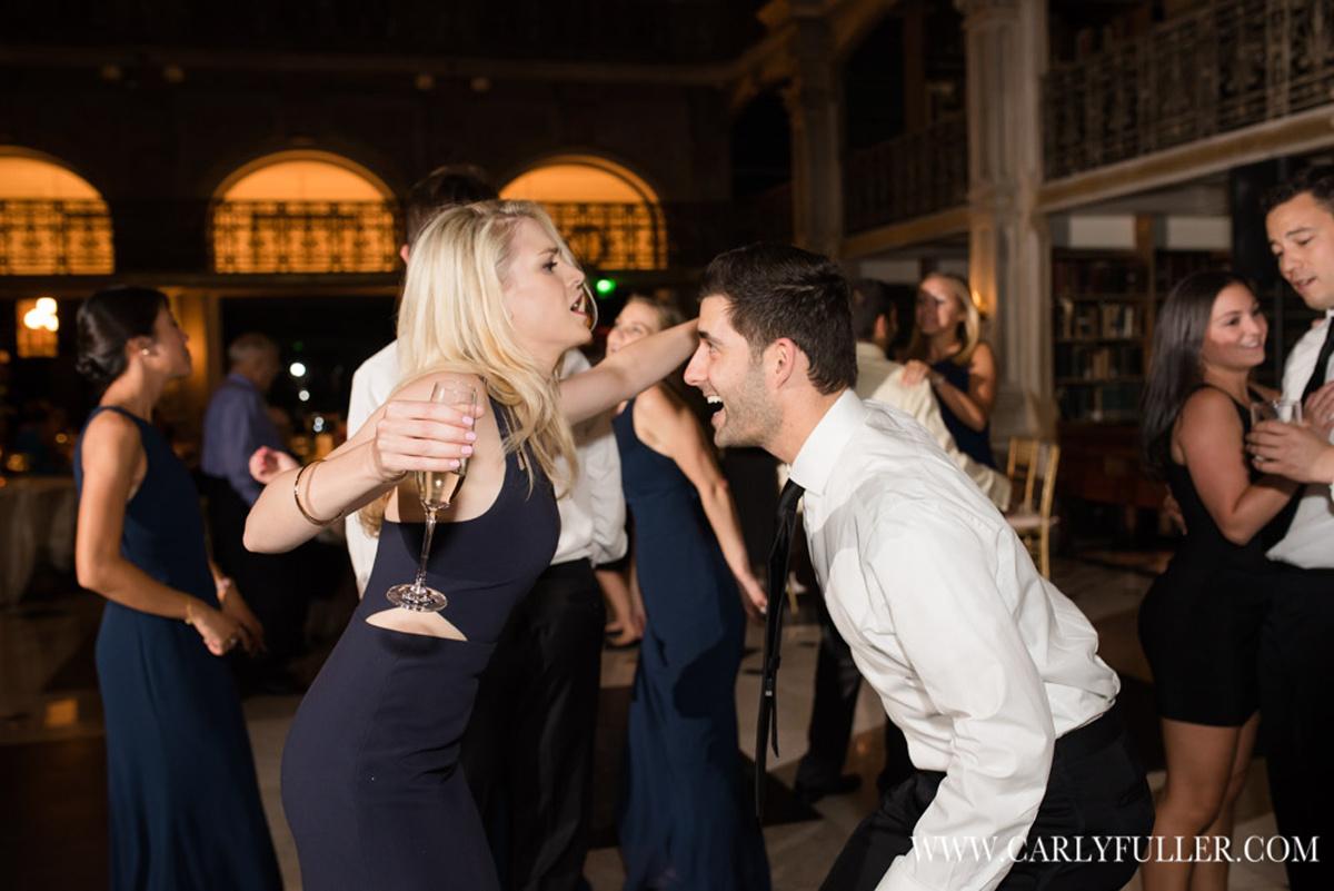 woman and man dancing at wedding