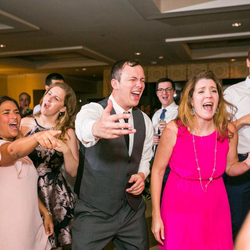 wedding guests singing on dance floor