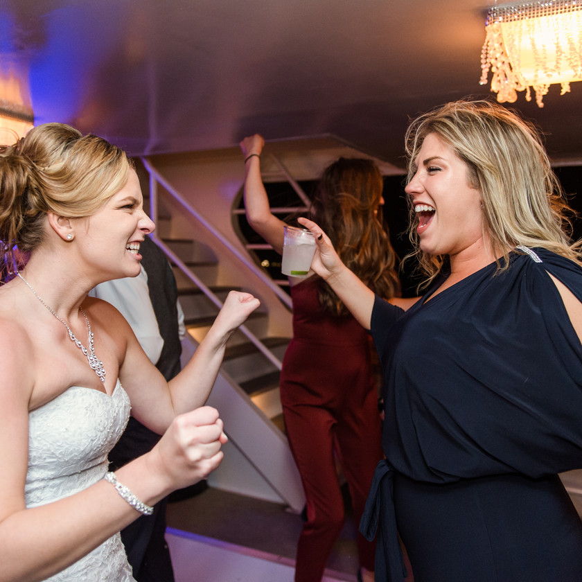 bride and woman dancing
