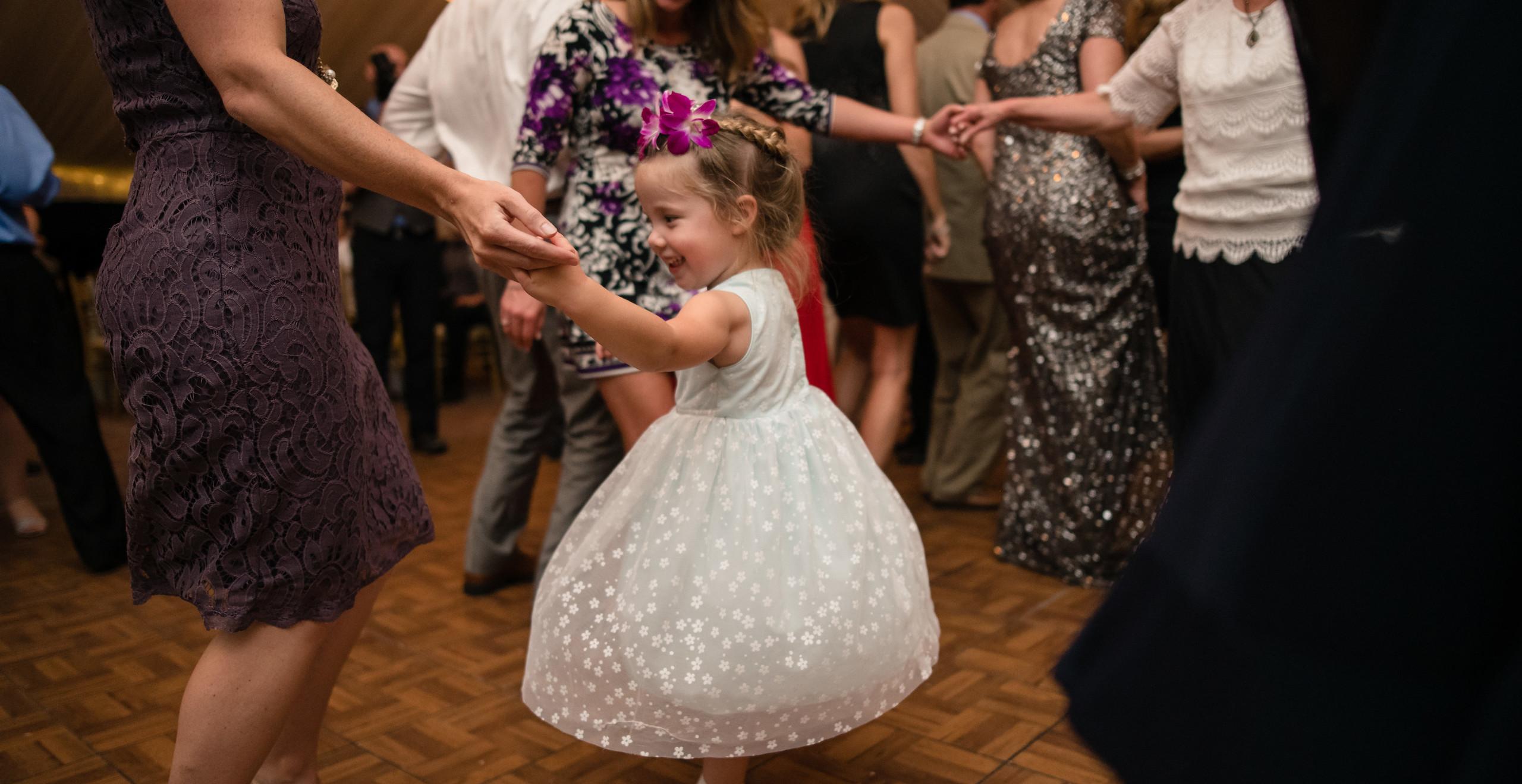 flowergirl dancing at wedding