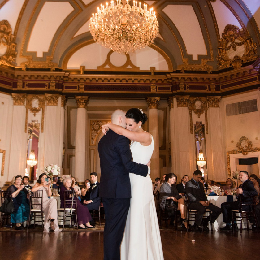 bride and groom first dance in ballroom