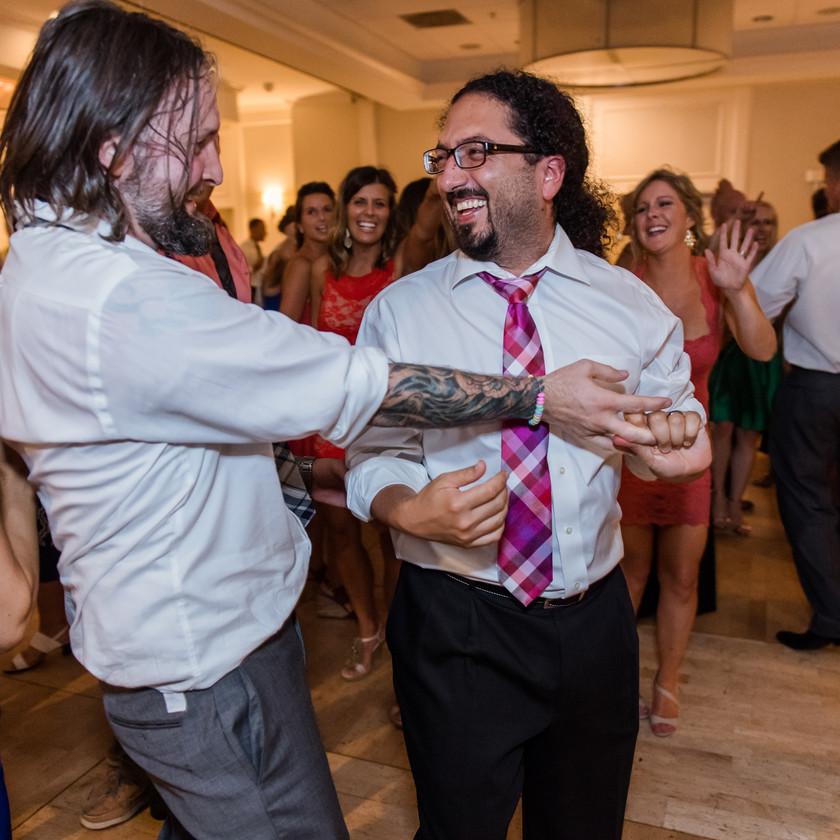 two guys dance at wedding