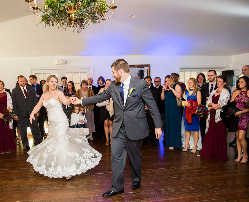 groom spins bride during first dance