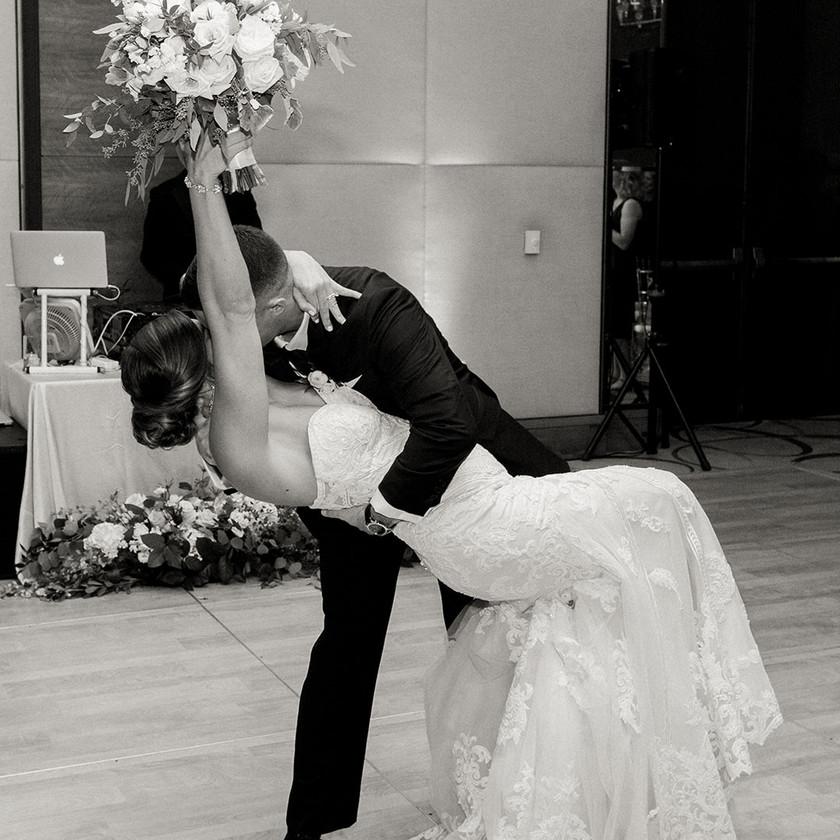 Four Seasons Baltimore wedding reception groom dipping the bride