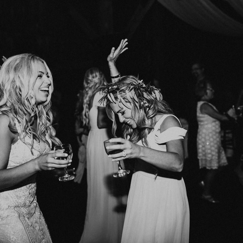 bride and bridesmaid dancing at wedding